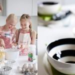 kaksi lasta ja aikuinen laittamassa ruokaa